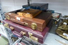 A LEATHER CASED TRAVELLING BACKGAMMON SET; TWO MAGNIFYING GLASSES AND A WOODEN SOLITAIRE BOARD AND