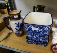 A PAIR OF DOULTON POTTERY BLUE AND WHITE FLORAL JUG VASES (ONE AS FOUND) AND A BLUE AND WHITE