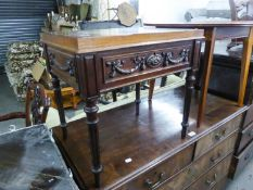 A MAHOGANY OBLONG LAMP TABLE WITH FESTOON CARVED APRON