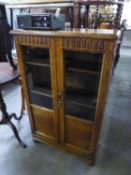 SMALL OAK BOOKCASE WITH GLAZED DOORS