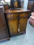 A REPRODUCTION SHALLOW BOW FRONT SIDE CABINET (BEVAN, FUNNELL)
