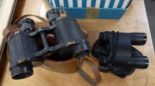 A PAIR OF FIELD BINOCULARS IN LEATHER CASE AND A PAIR OF MODERN FOLD-AWAY BINOCULARS (2)