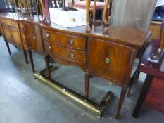 A REPRODUCTION MAHOGANY SERPENTINE FRONT SIDEBOARD (JAYCEE)