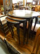 A NEST OF THREE QUARTERED MAHOGANY OVAL COFFEE TABLES