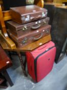 THREE GOOD QUALITY LEATHER BOUND SUITCASES, VARIOUS SIZES AND A LARGE MODERN SUITCASE (4)