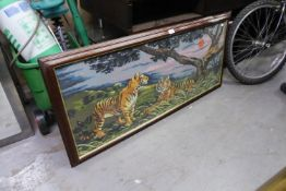 A LARGE PICTORIAL NEEDLEWORK TAPESTRY, LANDSCAPE WITH TIGERS, 18? X 44?, FRAMED AND GLAZED
