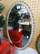 OVAL WALL MIRROR IN GILT FRAME