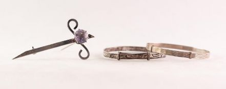 SCOTTISH SILVER CLAYMORE SHAPED BROOCH, claw set with a circular amethyst, 2 1/2in (6.3cm) long,