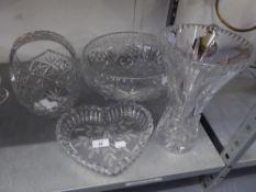 A LARGE CUT GLASS CIRCULAR BOWL RAISED ON THREE SCROLL FEET, 11 ½? DIAMETER; A CUT GLASS BASKET
