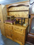A MODERN PINE WELSH DRESSER WITH TWO TIER RAISED PLATE RACK