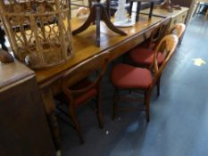 A SATIN WALNUT FARMHOUSE KITCHEN TABLE (190cm x 94cm) AND A SET OF 7 SINGLE DINING CHAIRS, WITH