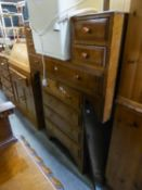 A LIGHT OAK CHEST OF FOUR LONG DRAWERS AND THE SUNK CENTRE DRESSING TABLE WITH FRAMELESS MIRROR