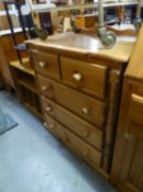 A PINE CHEST OF TWO SHORT AND THREE LONG DRAWERS