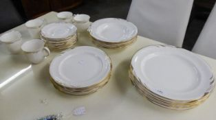 A PART ROYAL ALBERT 'DORIAN' DINNER AND TEA SERVICE OF 32 PIECES, WHITE WITH GILT DECORATION