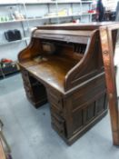 A LARGE OAK ROLL TOP DOUBLE PEDESTAL DESK WITH SERPENTINE SHUTTER, WITH MECHANICAL FOLD-AWAY SECTION