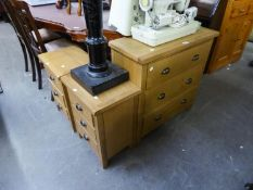 A PAIR OF LIGHT OAK THREE DRAWER BEDSIDE CHESTS WITH METAL CUP HANDLES AND THE MATCHING CHEST OF
