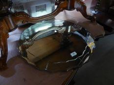 A CIRCULAR FRAMELESS WALL MIRROR WITH WAVY BEVELLED EDGE, 2? DIAMETER; A MAHOGANY TRIPOD WINE TABLE,