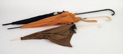 EARLY 20th CENTURY BROWN SILK PARASOL with carved ivory crook handle and ivory finials to the