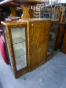 BURR WALNUT DISPLAY CABINET HAVING CENTRAL CUPBOARD DOOR BETWEEN ETCHED GLASS FRONTED DOOR