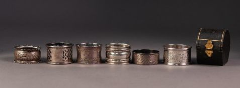FIVE VICTORIAN AND LATER SILVER NAPKIN RINGS, including, a CASED EXAMPLE, scroll engraved,