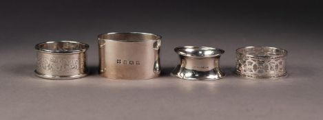 FOUR VARIOUS GEORGE V SILVER NAPKIN RINGS, including a HEAVY PLAIN, OVAL example, another pierced,