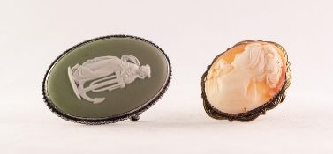 WEDGWOOD GREEN AND WHITE JASPER WARE OVAL BROOCH depicting a classical female figure leaning on an
