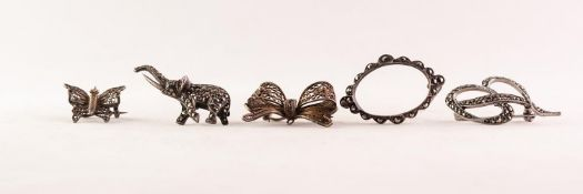 SILVER AND MARCASITE ELEPHANT BROOCH with ruby eye, 1 1/2in (3.8cm) long, with safety chain;
