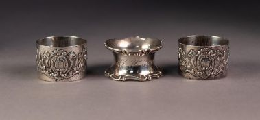 EDWARD VII THREE SILVER NAPKIN RINGS, comprising: A PAIR, repousse with cartouche and foliate