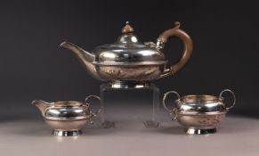GEORGE V THREE PIECE BACHELORS SILVER TEA SET BY MAPPIN & WEBB, of squat form with circular bases,
