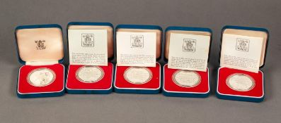 FIVE ?QUEENS SILVER JUBILEE? SILVER PROOF CROWN COINS, four supplied with booklet and all cased