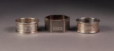 THREE SILVER NAPKIN RINGS, including a HEXAGONAL ENGINE TURNED example, Birmingham 1951, all