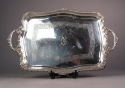 GEORGE V SILVER TWO HANDLED TRAY, of oblong form with gadrooned border to the serpentine outline,
