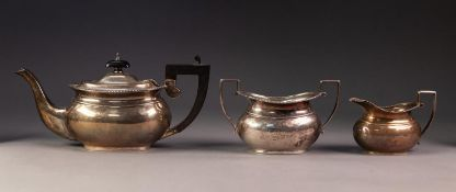 GEORGE V THREE PIECE SILVER TEA SET, of oval bellied form with angular black scroll handle and knop,