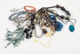 FIFTEEN INTERESTING NECKLACES including some hardstone, a branch coral necklace, a lava bead