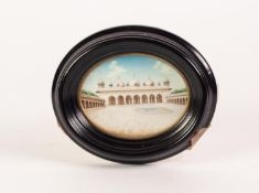 EARLY TWENTIETH CENTURY INDIAN OVAL MINIATURE OF A PALACE AND COURTYARD, with arched front to main