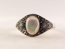 SUARTI SILVER TORQUE BANGLE, the broad top set with a large cabochon oval mother of pearl, with