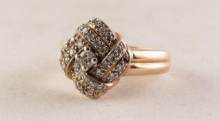 9ct GOLD AND DIAMOND SQUARE KNOT PATTERN DIAMOND CLUSTER RING set with centre diamond