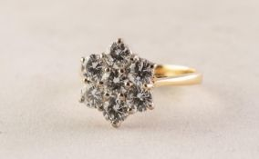 18ct GOLD AND DIAMOND DAISY CLUSTER RING, claw set with seven round brilliant cut diamonds, each