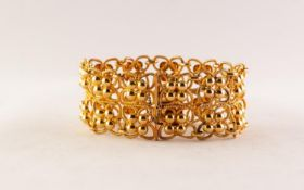 ITALIAN GOLD COLOURED METAL BROAD OPENWORK BRACELET with two rows of quatrefoil links, each with a