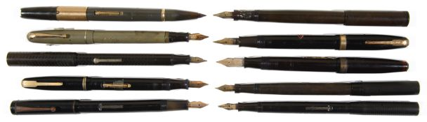 A large collection of fountain pens and spare/incomplete pen parts from the early 20th c