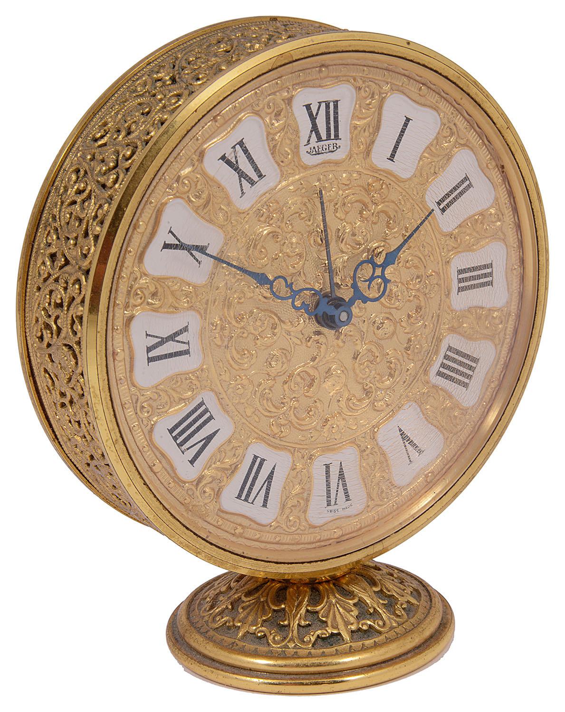 Lot 31 - A Jaeger gilt brass circular alarm clock