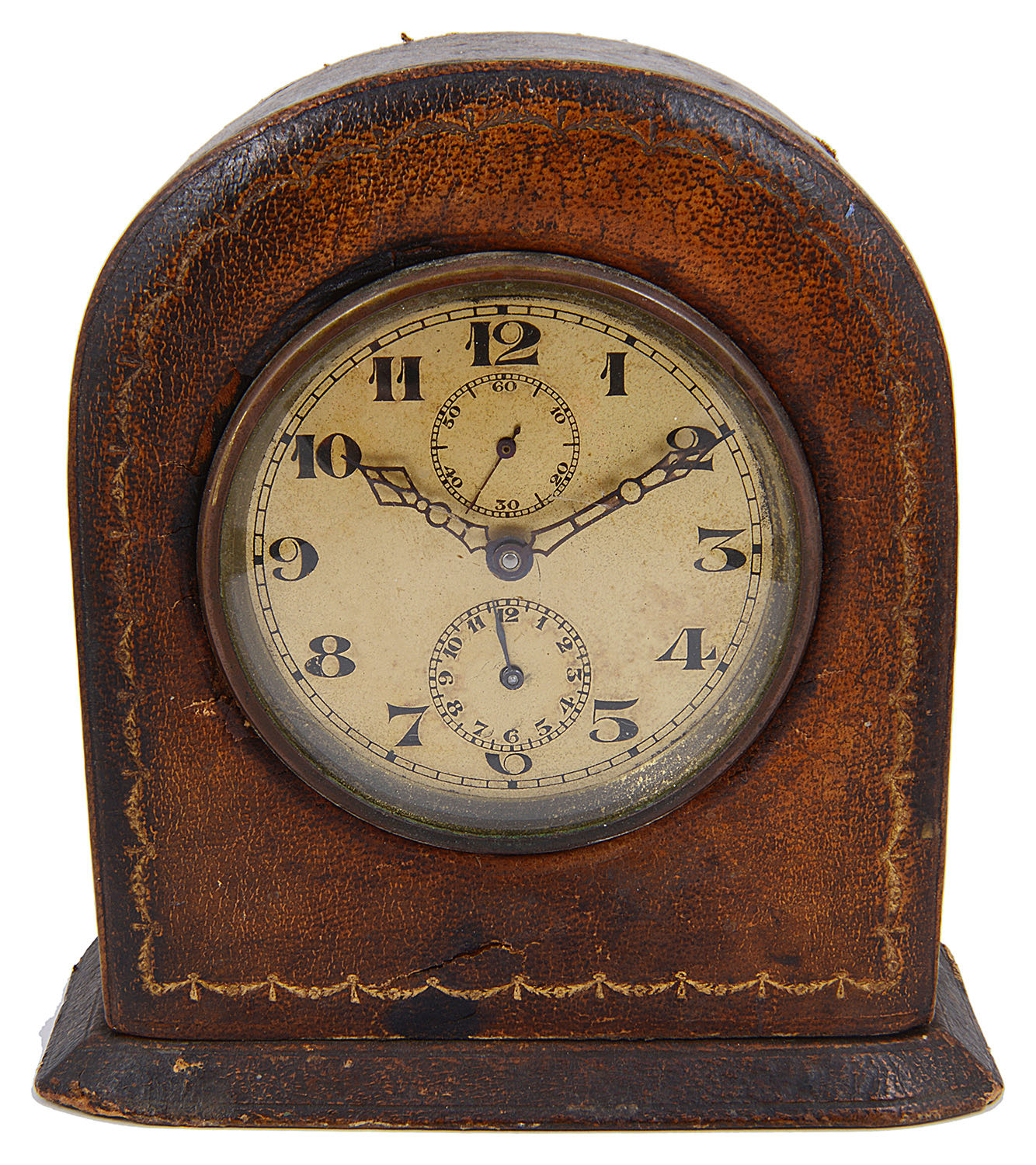 Lot 32 - An early 20th century gilt tooled leather arched desk clock
