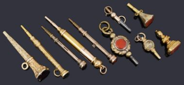 A small collection of 19th c gold clad and yellow metal watch keys and propelling pencils