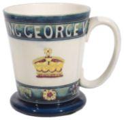A Moorcroft pottery George VI 1937 Coronation Commemorative Mug