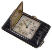 An Art Deco black enamel and gilt purse watch