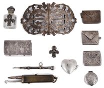 An Edwardian silver nurses buckle, silver stamp envelopes; others