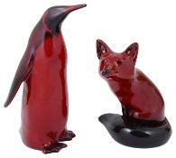 A Royal Doulton flambé penguin and fox