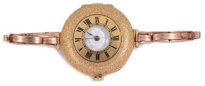 An 18k Swiss gold ladies half hunter wristwatch