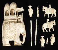 A late 19th c Indian ivory carving of an elephant with howdah and attendants