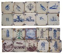 A collection of twenty Dutch Delft blue and white tiles